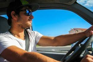 man drives car